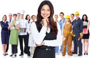 empowered female professional with group of other professionals